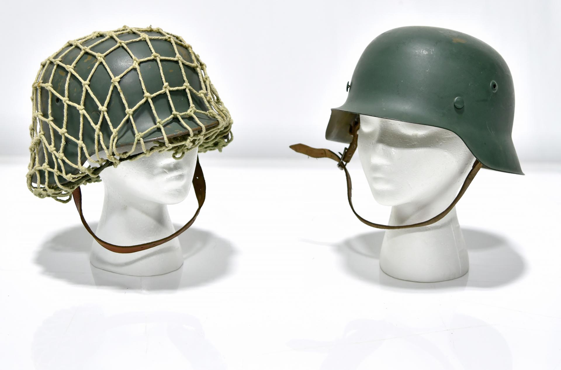 Lot of 2 WWII German Military Helmets - One with Camouflage Netting