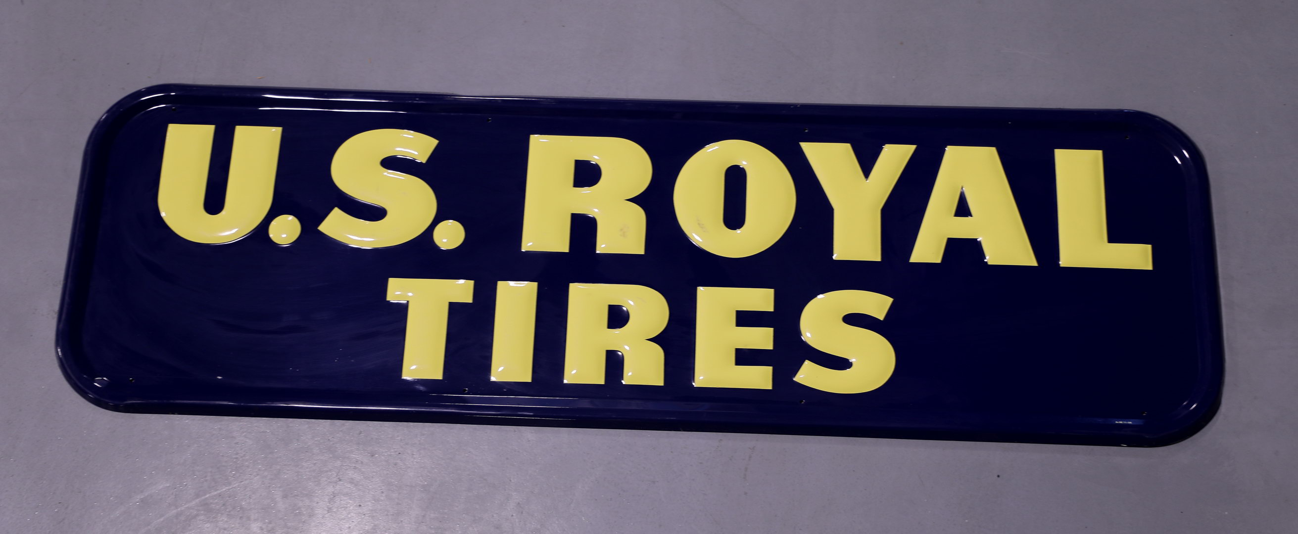 US Royal Tires Embossed Tin Advertising Sign