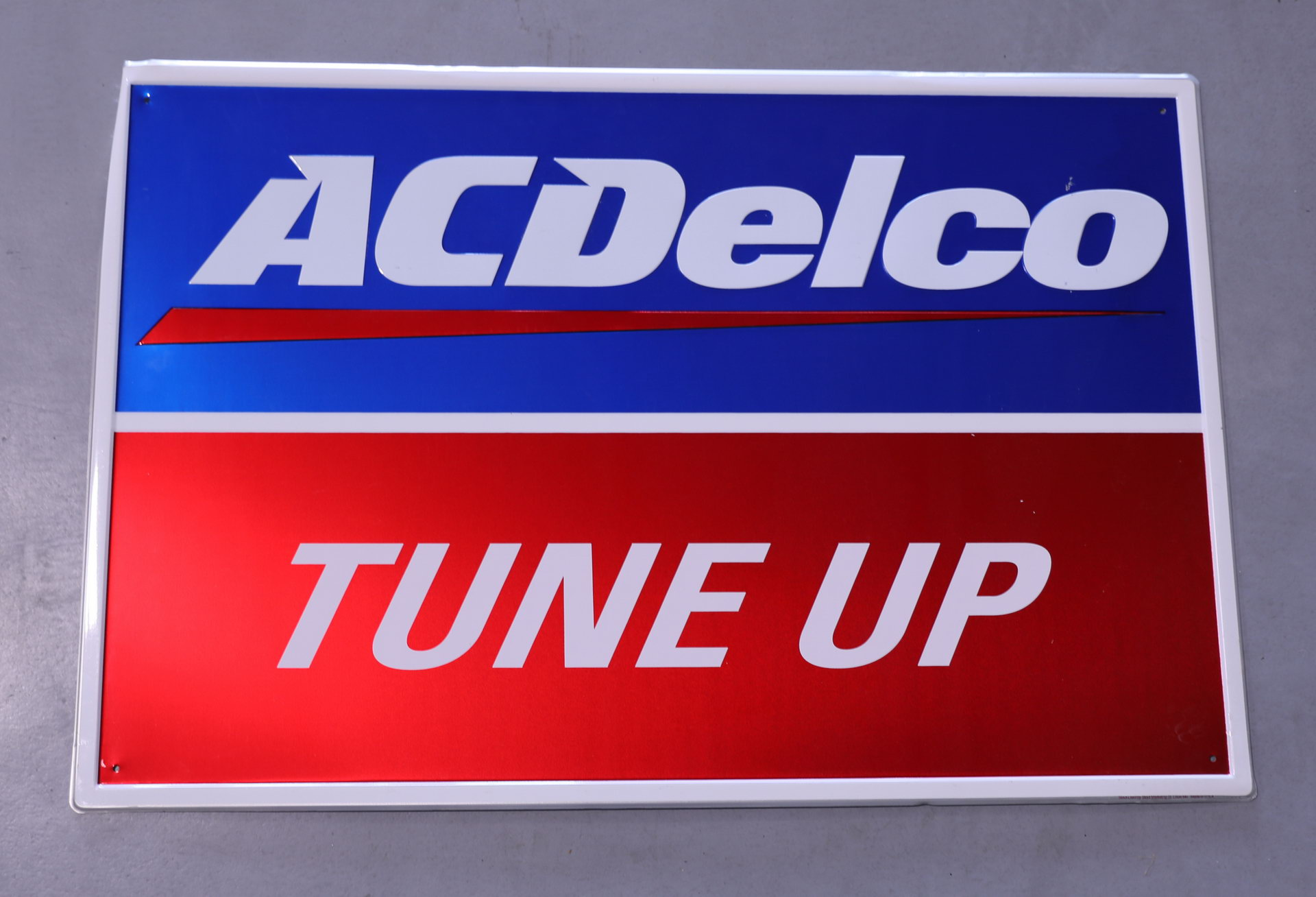 AC Delco Tune Up Tin Advertising Sign