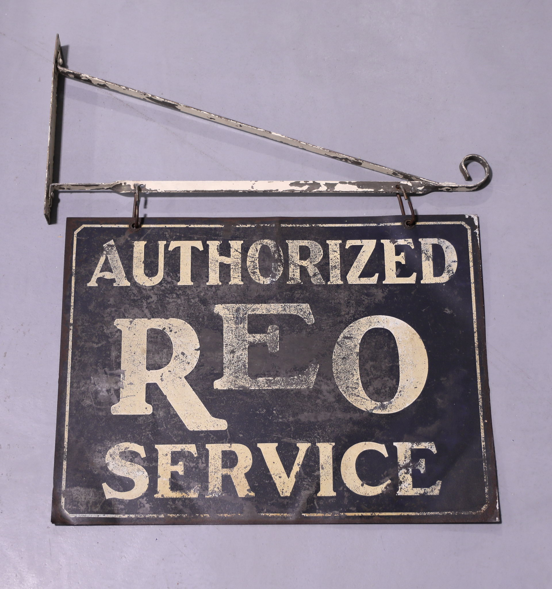 Early DSM REO Authorized Service Automobile Dealership Sign with Ornate Bracket